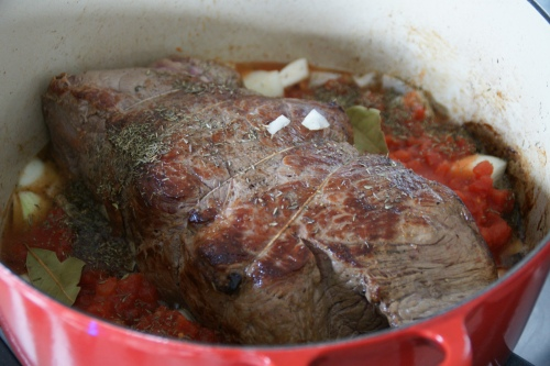 Surround the roast with the braising ingredients