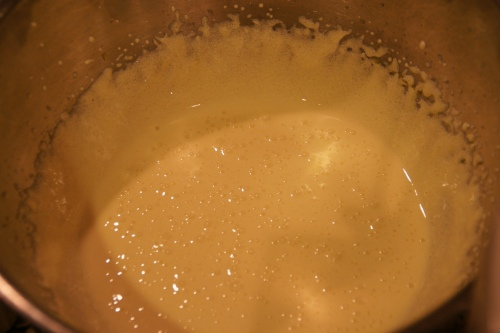 The egg  yolks will thin out slightly after adding the liqueur