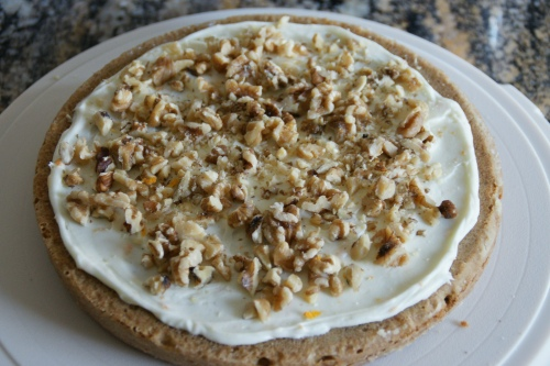Crunch walnuts and orange-flavored cream cheese frosting