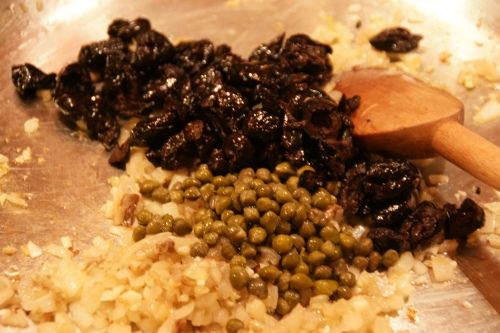 Tangy capers and olives.  Use the oil-cured (wrinkly) kind-- they are less salty than brined ones