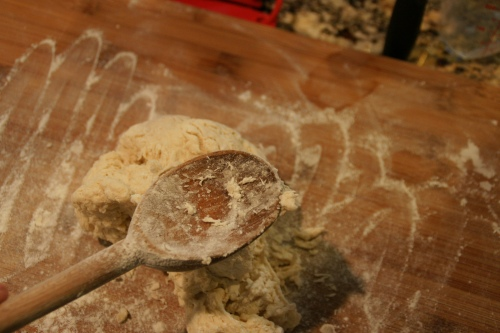 I use flour to rub off any sticky bits clinging to the wooden spoon