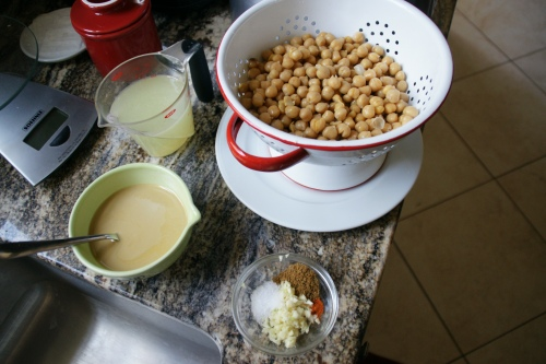 Mise en place: 1) lemon water, 2) tahini olive oil, 3) garlic and spices, 4) drained chickpies.